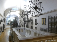 View of a piece of the wrought iron gallery