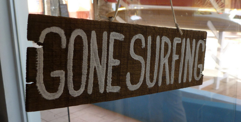 gone surfing sign hanging in window