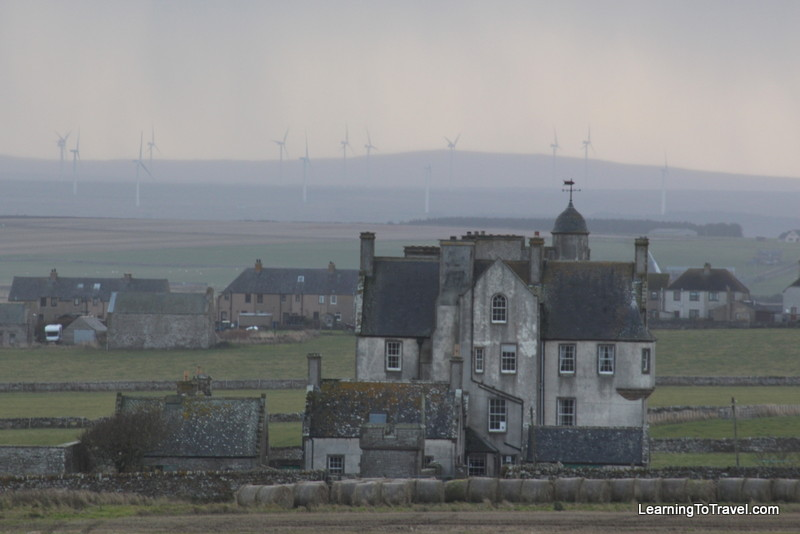 Scottish wind farm and old house