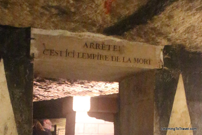 """""""Halt! Here lies the empire of the dead."""" Sign at the entrance to the section of the catacombs with bones. Very Lord of the Rings-ish, I thought."""