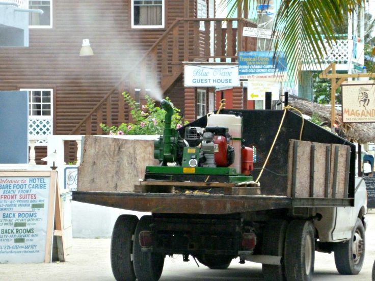 a truck spraying for mosquitoes in caye caulker belize