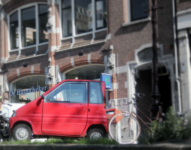small red car in amsterdam