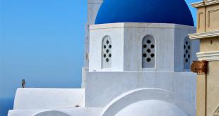 blue church in santorini greece