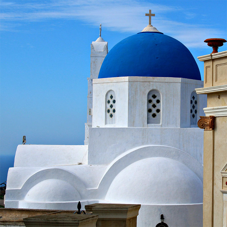 blue church in santorini greece